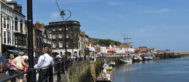 Whitby - tourists milling around and the harbour in view