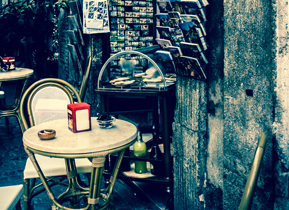 Split tone edit of a side-street cafe in Rome titled Cafe del Presidente