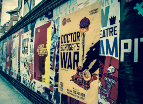 Production posters line the wall outside the Globe Theatre, London