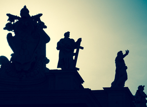 silhouette of the saints on-top of the collonades in St Peter's square, Rome