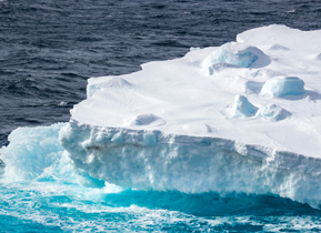 A giant iceberg floats past the MS Expedition in the Gerlache straight
