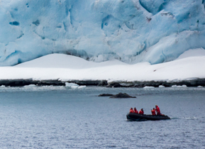A Zodiac boat scouts the conditions of the pack ice