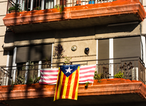Balcony adorned with the flag of Barcelona