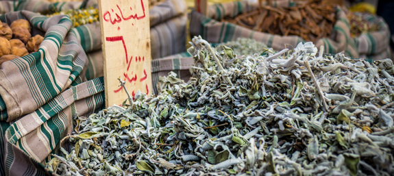 Spices a heaped in bags in the markets of Amman's side-streets