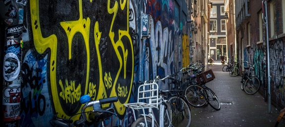 A side street in Amsterdam covered with graffiti