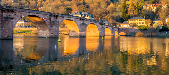 The majestic Alte Brucke bridge and the reflective Neckar river