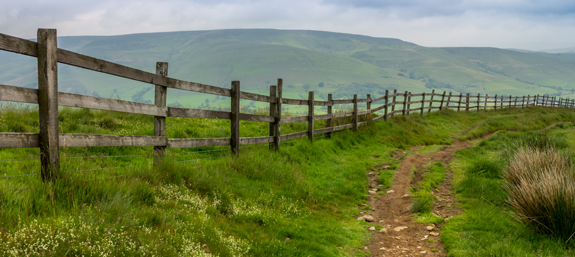 Mam Tor Bridleway with the Peak District valleys looming in the background