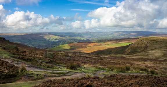 Brightly coloured fields and hills in the Peak District